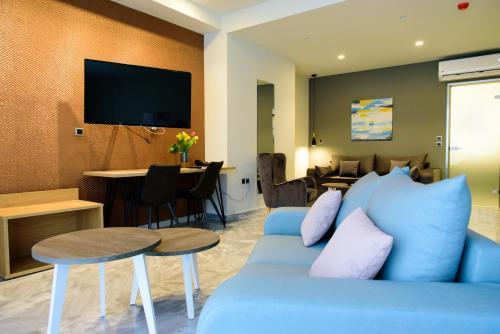 A television and/or entertainment center at Eva Apartments
