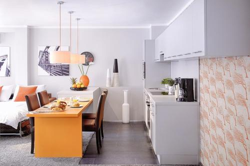 A kitchen or kitchenette at Concept Living Munich Serviced Apartments