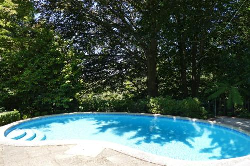 The swimming pool at or near Manor Park Studio