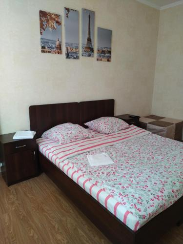 A bed or beds in a room at Volodarsky Apartment