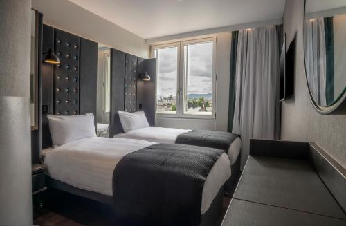 A bed or beds in a room at Point A Hotel Edinburgh Haymarket