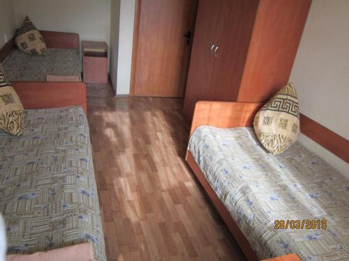 Кровать или кровати в номере Гостиница Динамо