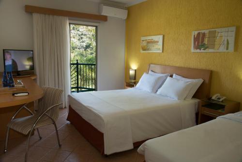 Cama ou camas em um quarto em Oscar Inn Eco Resort