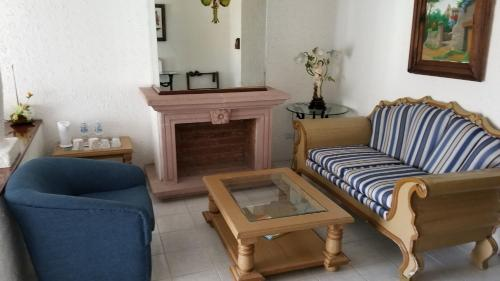Area soggiorno di Gran Hotel Hacienda De La Noria