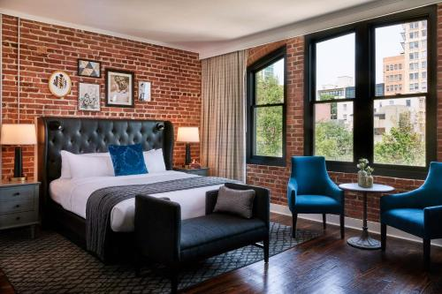 A bed or beds in a room at Foundry Hotel Asheville, Curio Collection By Hilton
