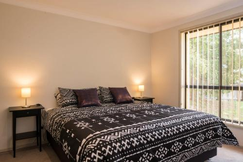 A bed or beds in a room at Le Grand Armidale - NSW