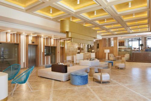 De lobby of receptie bij Hotel Nobel - Beach Access