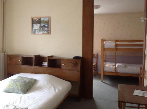 Un ou plusieurs lits dans un hébergement de l'établissement Auberge De La Plaine