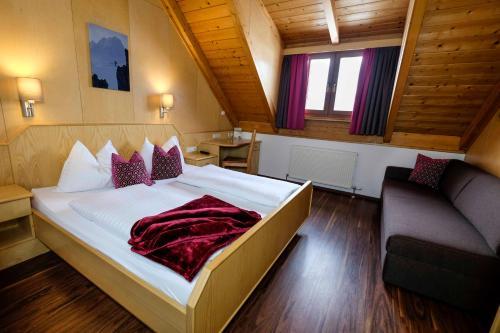Ein Bett oder Betten in einem Zimmer der Unterkunft Aktiv Hotel Karnia