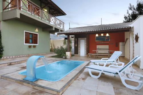 The swimming pool at or close to Porto Seguro Flat