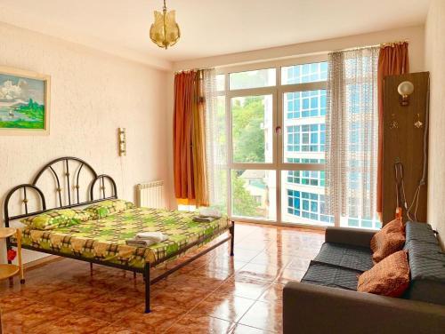 Кровать или кровати в номере Apartment Nagornaya 19