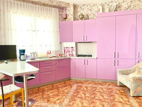 Кухня или мини-кухня в Apartment Nagornaya 19