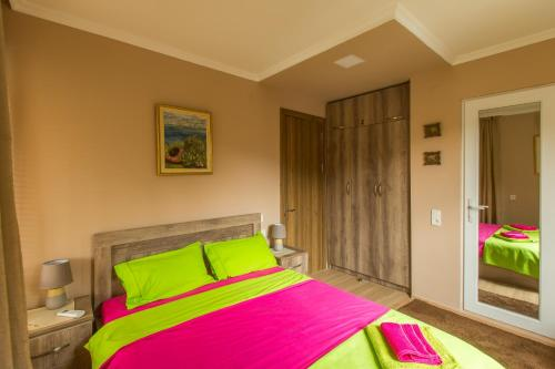 A bed or beds in a room at Mereti
