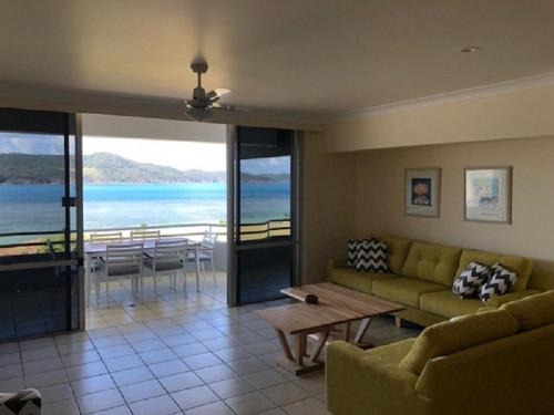 A seating area at Frangipani Beachfront Lodge 208 on Hamilton Island by HamoRent
