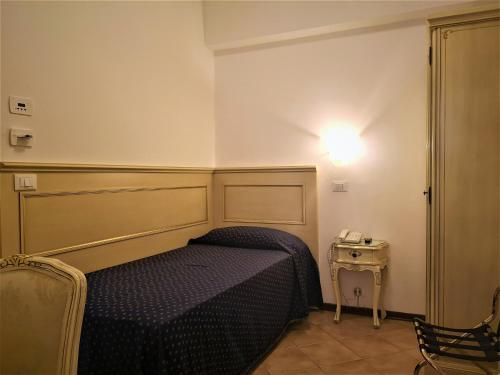 A bed or beds in a room at Hotel Guerrini