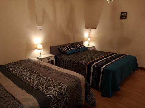 Un ou plusieurs lits dans un hébergement de l'établissement Gîte du Château Haut Lamouthe