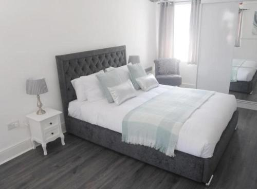 A bed or beds in a room at Bexley Village Hotel