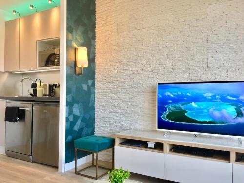 A television and/or entertainment centre at MyHome Riviera - Cannes Sea View Apartment Rentals