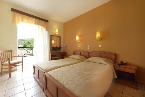 Кровать или кровати в номере Amalia