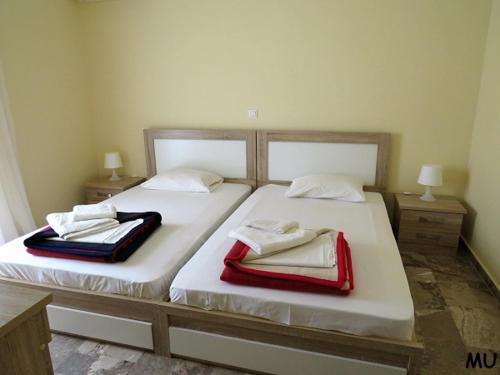 A bed or beds in a room at Holiday Dream Thalia Apartment
