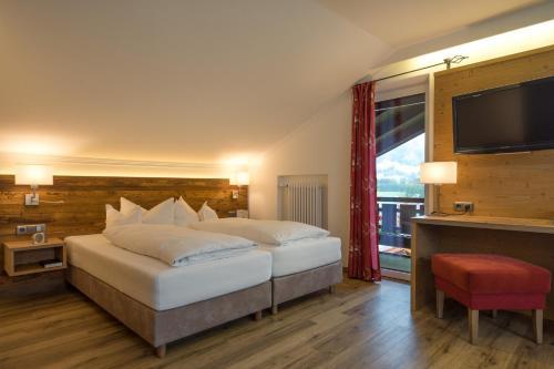 Ein Bett oder Betten in einem Zimmer der Unterkunft Wohlfühlhotel Berwanger Hof