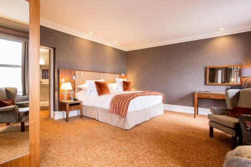 A bed or beds in a room at Slieve Donard Resort & Spa