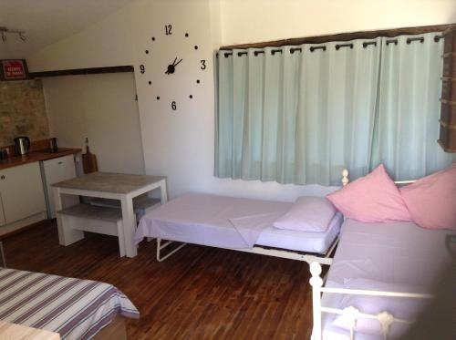 A bed or beds in a room at La Sonnette B&B