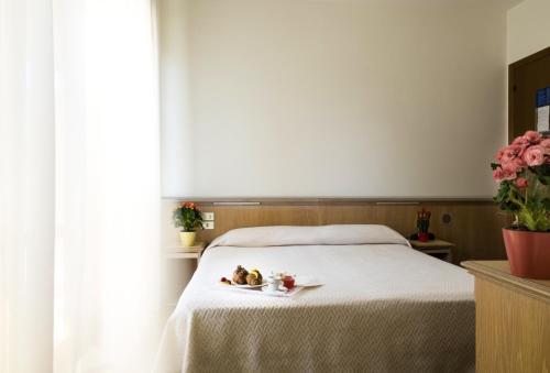 Letto o letti in una camera di Hotel Esperia