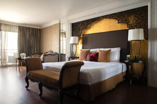 A bed or beds in a room at Jumeirah Zabeel Saray