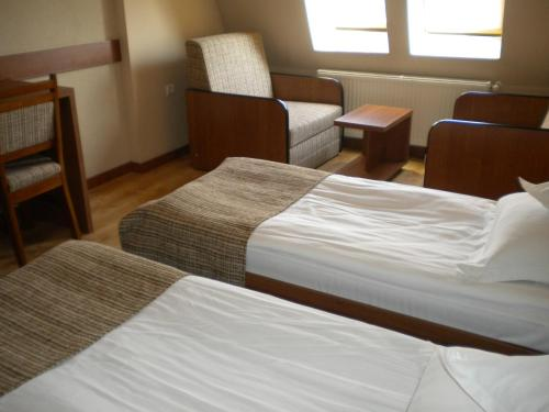 A bed or beds in a room at Hotel Crisana Arad