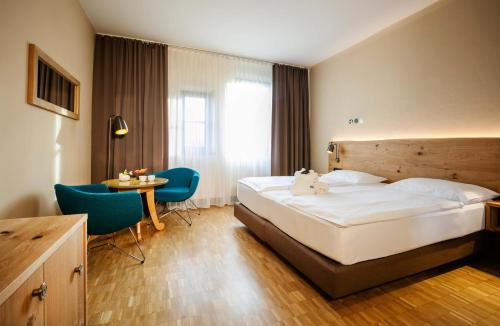 Ein Bett oder Betten in einem Zimmer der Unterkunft Rogner Bad Blumau