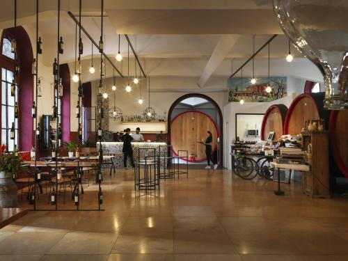 A restaurant or other place to eat at Cangrande Hotel