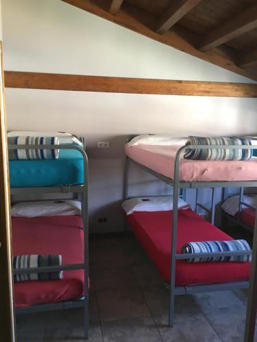 A bunk bed or bunk beds in a room at Albergue Santa Fe