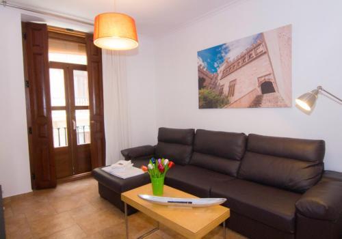 O zonă de relaxare la Living Valencia Apartments - Merced