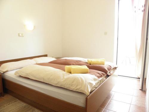 Un ou plusieurs lits dans un hébergement de l'établissement Rooms & Apartments Linda & Mario