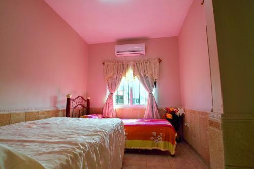 A bed or beds in a room at Casa Arletty Santa Marta