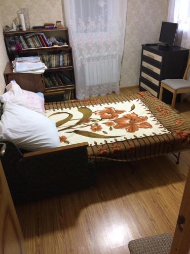 Кровать или кровати в номере ЛЛьва Толстого 46