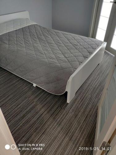 Кровать или кровати в номере Apartment Vinograd