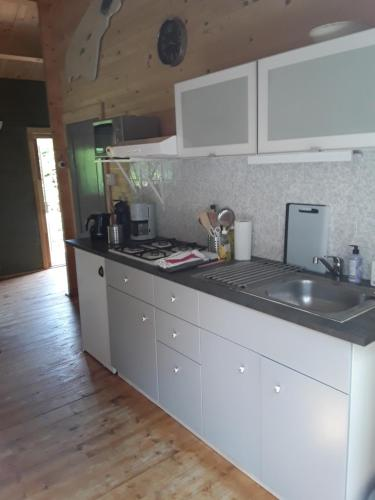 A kitchen or kitchenette at AmicitiA