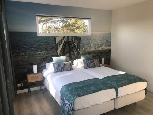 Ein Bett oder Betten in einem Zimmer der Unterkunft B&B de Getijden