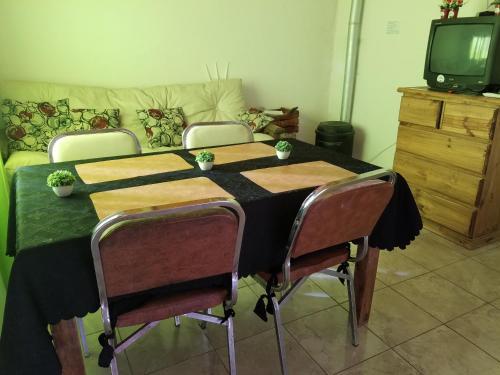 A seating area at Alojamiento San Rafael 3