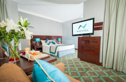 تلفاز و/أو أجهزة ترفيهية في Novel Hotel City Center