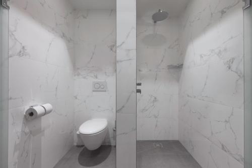Een badkamer bij Grand Hotel Valies