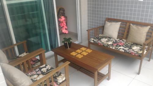 Uma área de estar em Apartamento temporada Arraial do Cabo