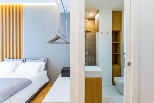 A bed or beds in a room at Concept Terrace Hotel