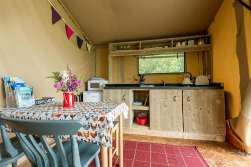 A kitchen or kitchenette at Kidwelly Glamping