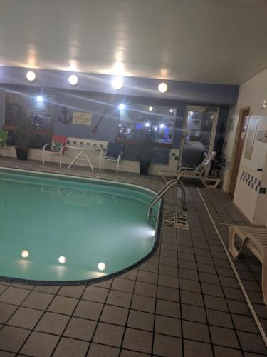 The swimming pool at or near AmericInn by Wyndham Davenport