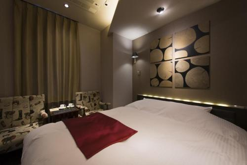 A bed or beds in a room at The CALM Hotel Tokyo