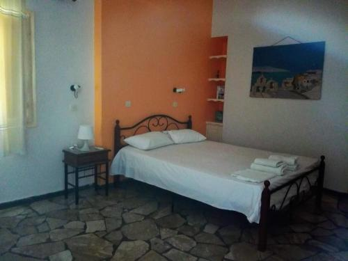 Ένα ή περισσότερα κρεβάτια σε δωμάτιο στο Πασόη