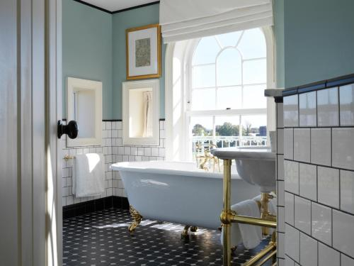 A bathroom at University Arms, Autograph Collection